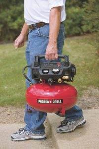 Person Carrying A Compact Air Compressor